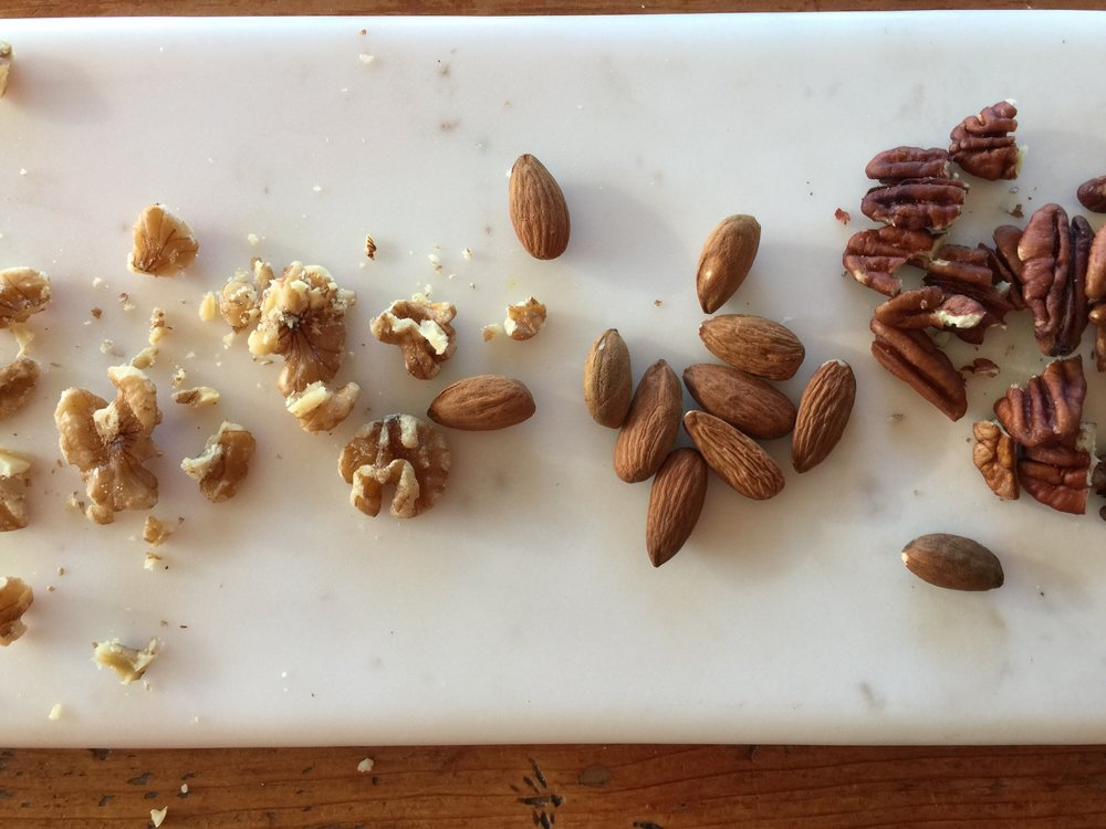 Pecans, Walnuts and Almonds. Pecans and Almonds are the musts. Peanuts, cashews, walnuts work great too.
