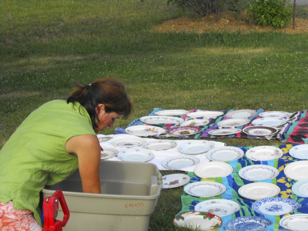 Unpacking the first batch of dishes I collected for events held in the barn