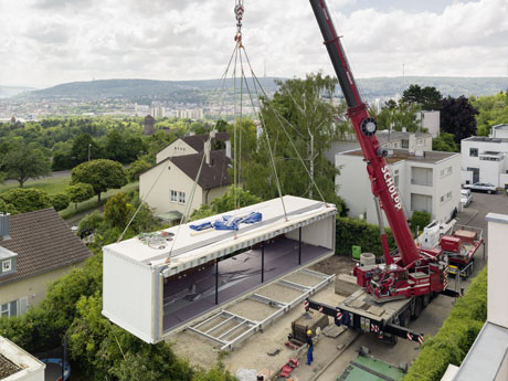 The Aktiv Haus being craned into position