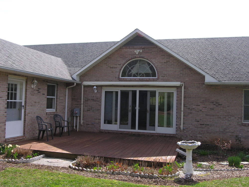 Exterior 6.5-Back patio with Sunsetter Awning.JPG