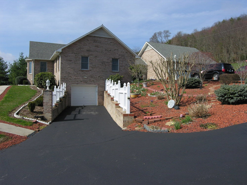 Exterior 7-End with Landscaping and 2-car garage.JPG