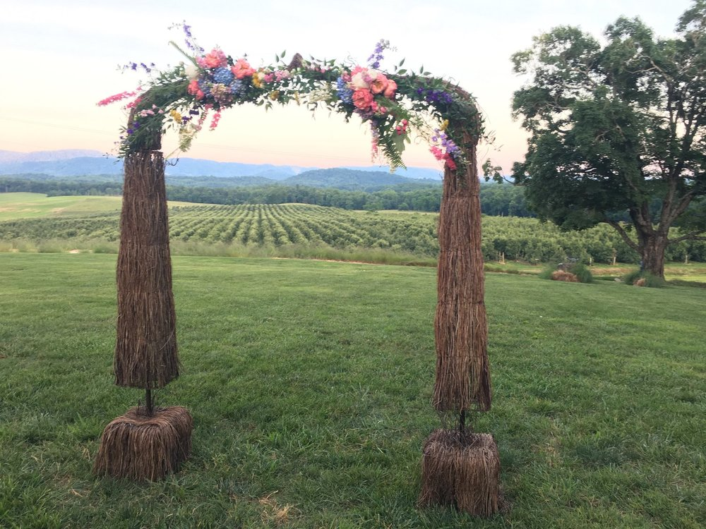 Arbor - Grapevine $50.00 (Cost with flowers depends on what you want)