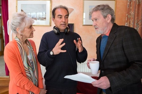 On set with director Kae Bahar, discussing script with stars Anita Dobson (left) and Paul Copley (right).