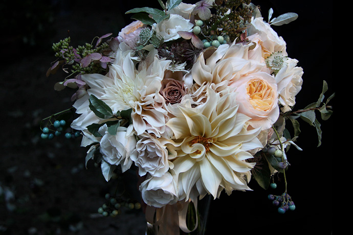 Nicolette Camille Floral Design - this medley is a combination of the sweetest neutrals. we absolutely love the over-sized dahlia as the focal point with soft and warm shades of green intertwined on the outer layers.