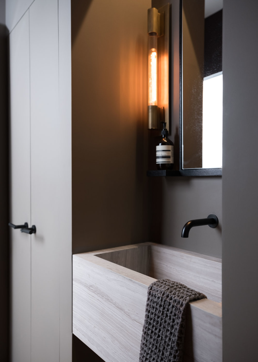 Mirror by Nafco  Materials: Ebonized oak & glass   Location: Powder Room,  Industrial Cast Iron Soho Loft
