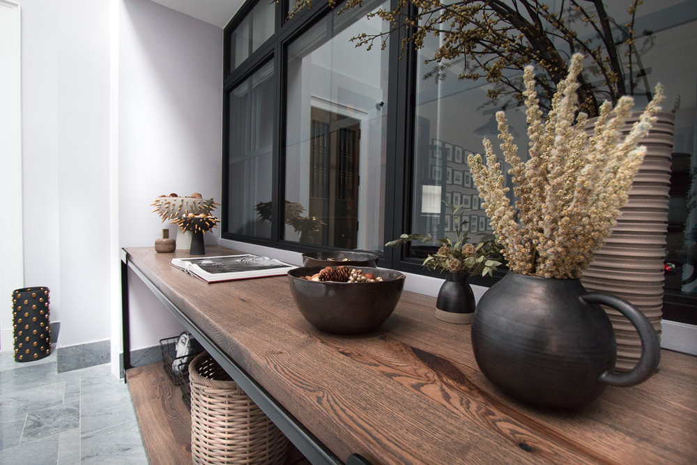 Table by Nafco  Materials: Powder coat blackened steel with oak  Location: Private Atrium Entryway,  West Village Maisonette - The Greenwich Lane