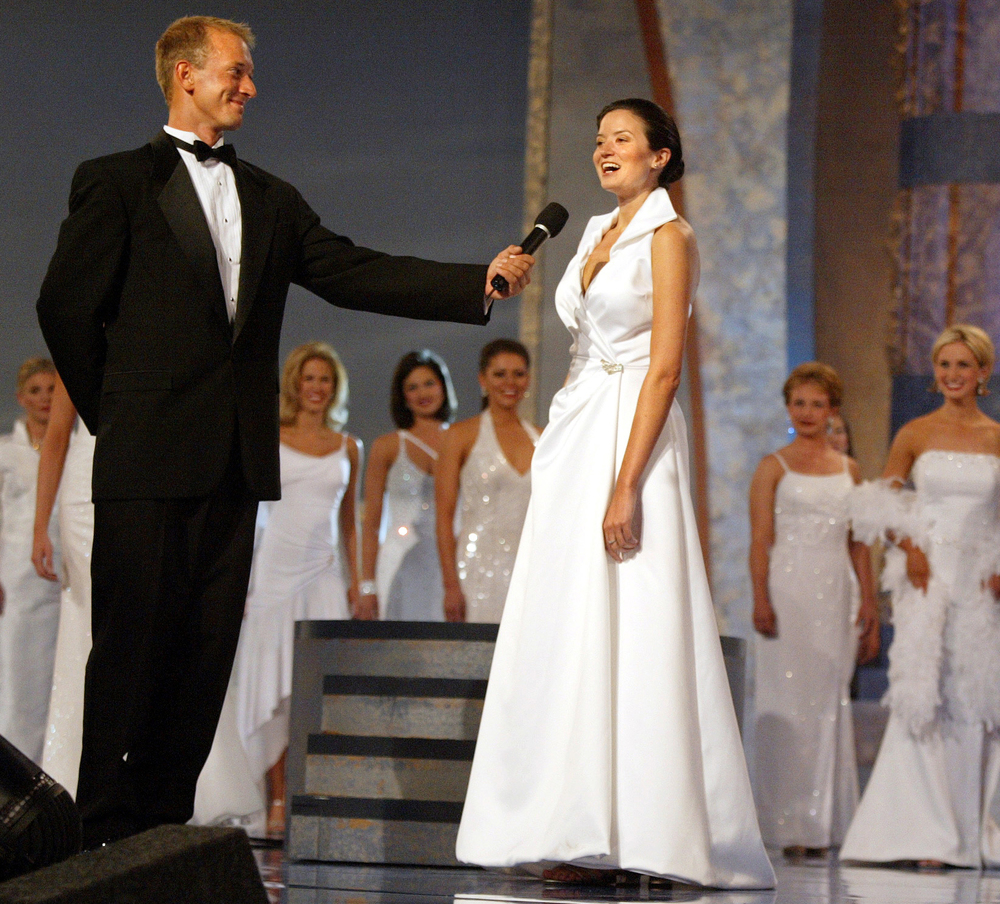 """If anyone was ever made for the Miss America stage, it was Olivia. Here, she introduces herself during the pageant's opening segment in Atlantic City in 2002 for a behind-the-scenes story. """"I can't stop marveling at my updo, as glossy and spongy as a meringue,"""" she wrote.  (Photo: Eileen Blass, USA TODAY)"""