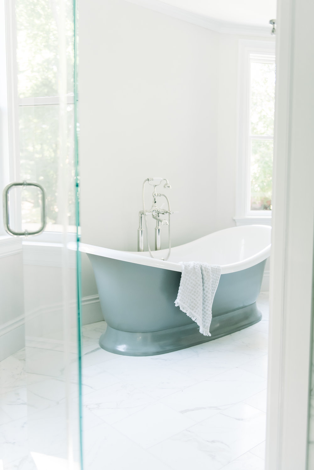 While cramming yourself into a shower stall… - to capture one of the most amazing tubs ever.