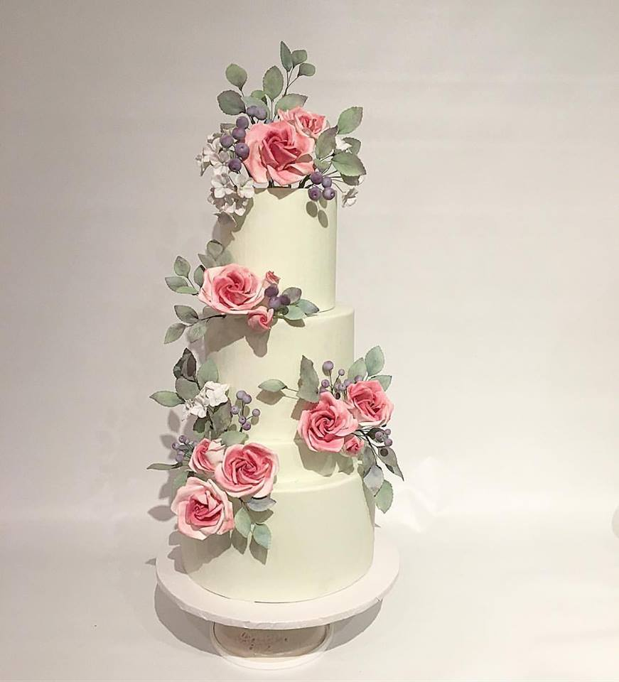 wedding cake with flowers on the side flower wedding cakes cake alchemy 26884