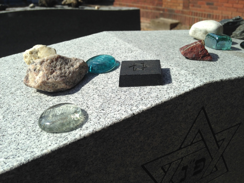 single MitzvahStone amidst pretty stones.jpg