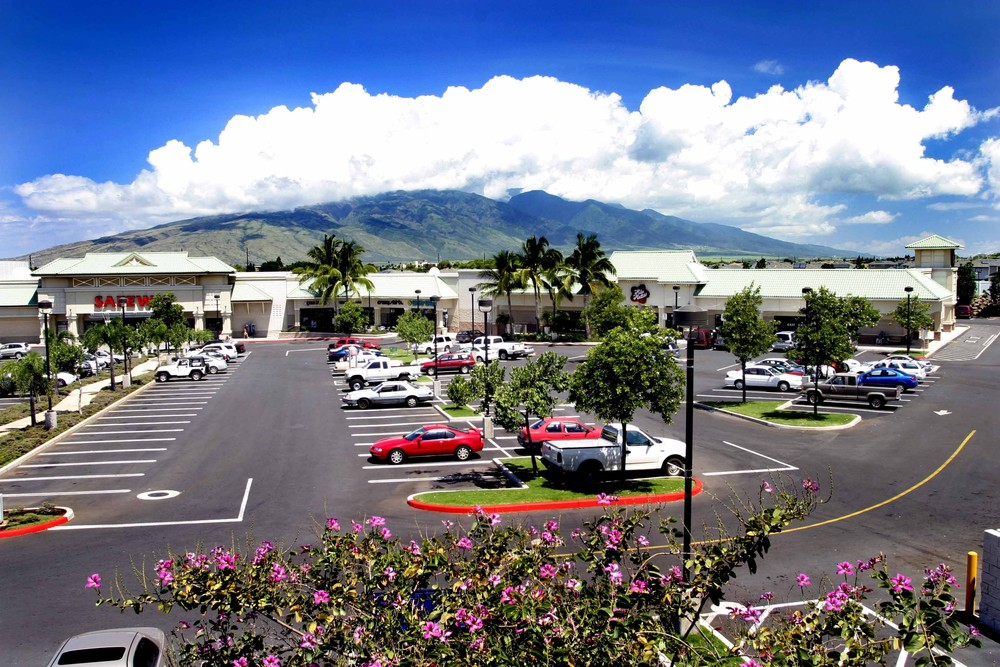 PI'ILANI VILLAGE  Kihei, Maui, HI  Located in South Maui, Pi'ilani Village was The Krausz Companies' first project in the Hawaiian Islands. The 148,821 SF shopping center is anchored by Safeway and features a unique tenant mix of national and regional tenants highlighted by Outback Steakhouse, Starbucks, Maui Tropix, and ABC Stores. The center also includes a professional medical facility which is home to the Kihei-Wailea Medical Center, Kimera Physical Therapy, Maui Diagnostic Imaging, and Clinical Laboratories of Hawaii.  After acquiring this property from the original developer partially-leased, we constructed additional leasable area and successfully implemented a leasing plan focused on serving both the local community and the seasonal tourist trade in order to sustain consistent revenue twelve months out of the year. Today, Pi'ilani Village is the dominant neighborhood center in the marketplace.