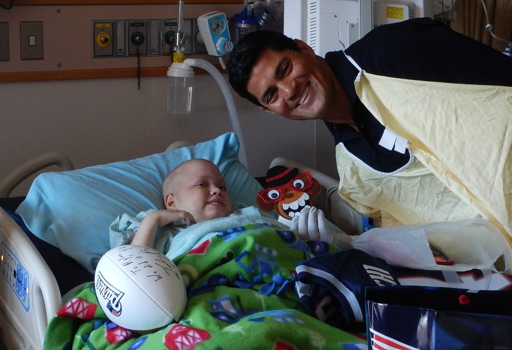 Rylan during his wish visit from former new england patriots player Tedy bruschi. Photo courtesy of: A Wish Come True, Inc.