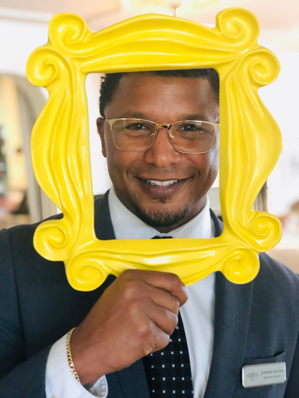 Restaurant Manager Jonathan using the picture frame from the hit television show  Friends .
