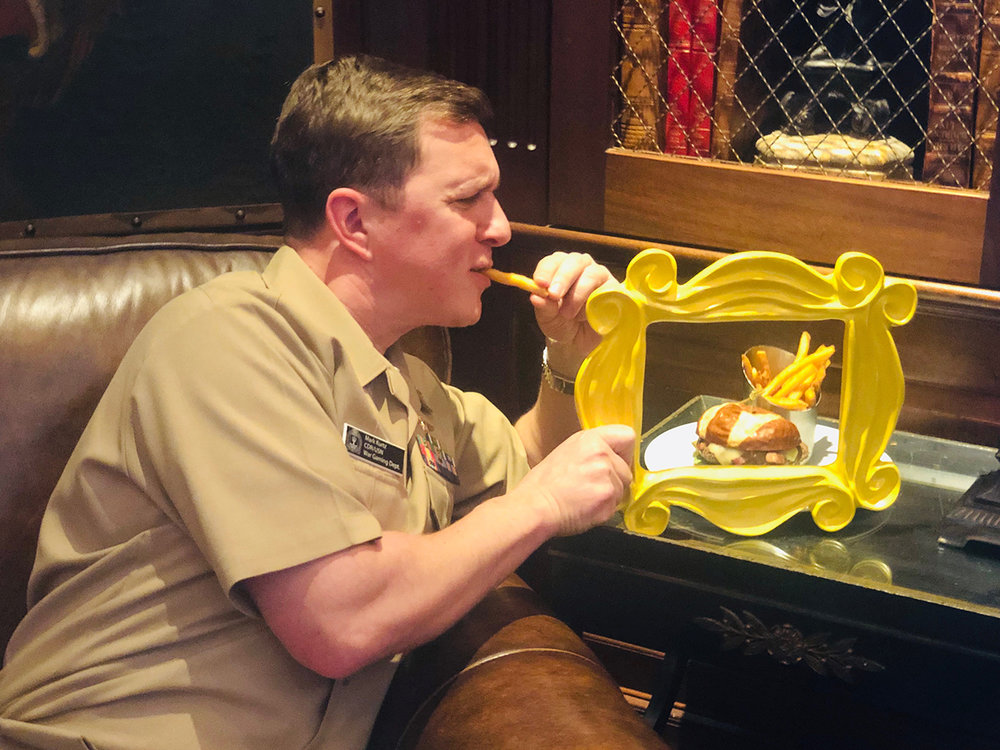 Commander Mark from the Naval War College enjoying more than just our burger.
