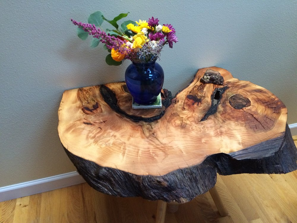 This burl slab table was made from an old Douglas Fir stump found in Blue Agate Woods, a Local Woods wood lot member.