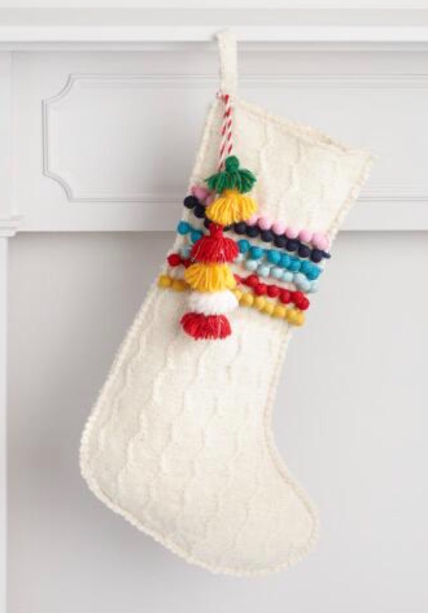 - First off...The Stocking! How sweet is this stocking I found at World Market. Perfect for a little boy... I was looking for a stocking that I could get his name embroidered on & I fell in love with the pom-pom & tassel detail.