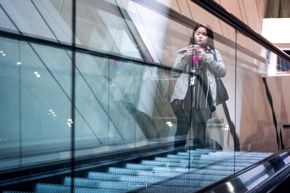 I saw the different colour temperatures on the entrance escalators and then tried to get this ghostly reflection photograph. Rode these escalators for about ten minutes