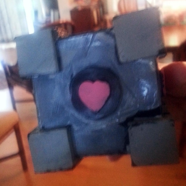 Q's very own, hand-made, artisinal Companion Cube.  Like a good artist he is not quite satisfied and wants to make some alterations.