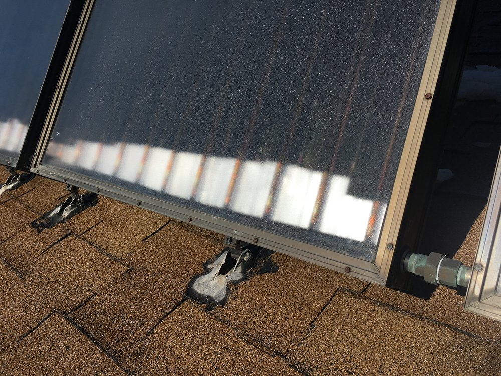 Damaged solar thermal panels and mounting feet