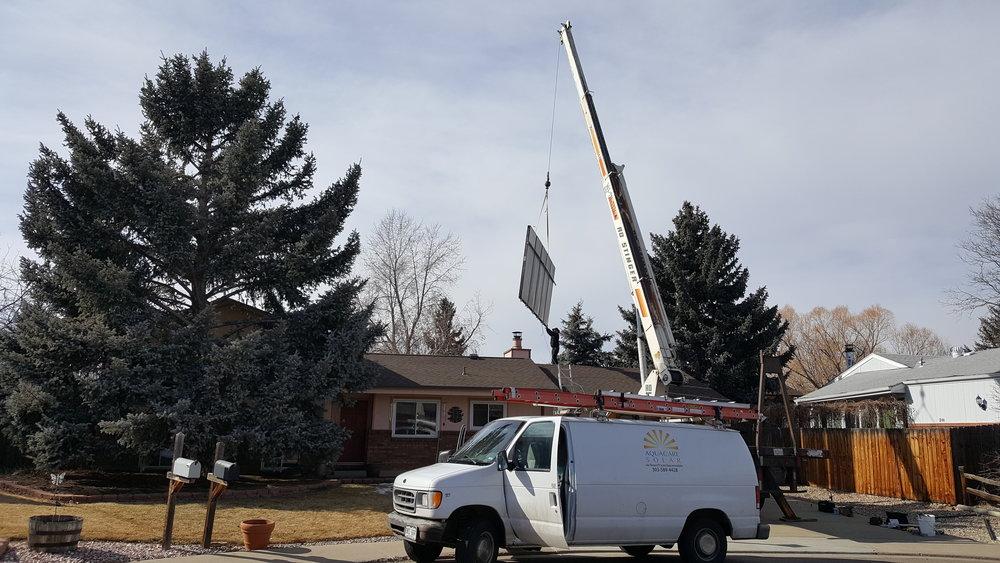 Crane reinstall of new solar thermal panels