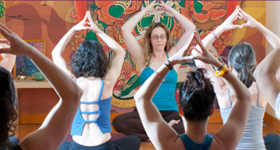 alyssa snow, teaching yoga at her studio