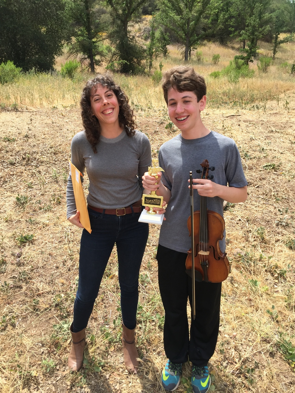 Michael and myself at the 55th Annual Topnaga Banjo Fiddle Contest holding the 1st place trophy for Beginner Fiddle.