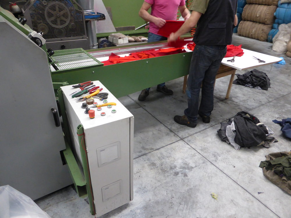 Experimenting with Industrial machineries: garments are assorted by color and fed into the shredder.