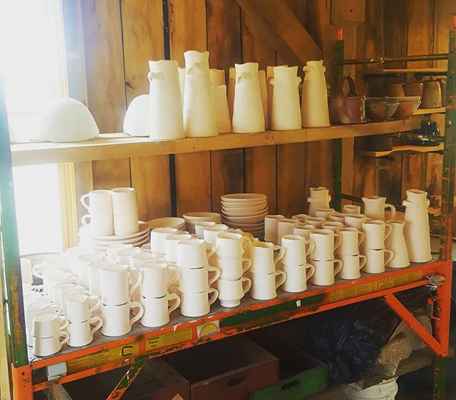 Ready for glaze. Lots of mugs and a 10 pc. dinnerware set for Dan at Conder Sawmill! Using his wood scraps for the firing!  #fullcircle  #woodfiredpottery #porcelain #coffee #studiopottery