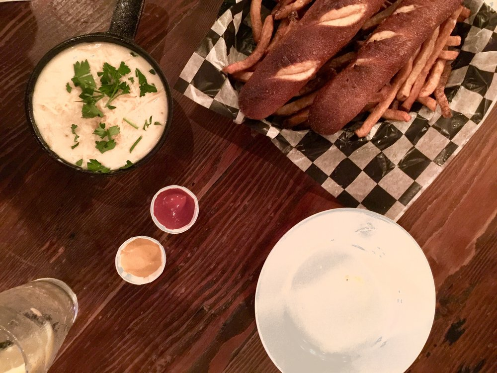 Beer cheese dip, with crispy fries and warm, soft pretzels. - Photo by Britt Shoffner