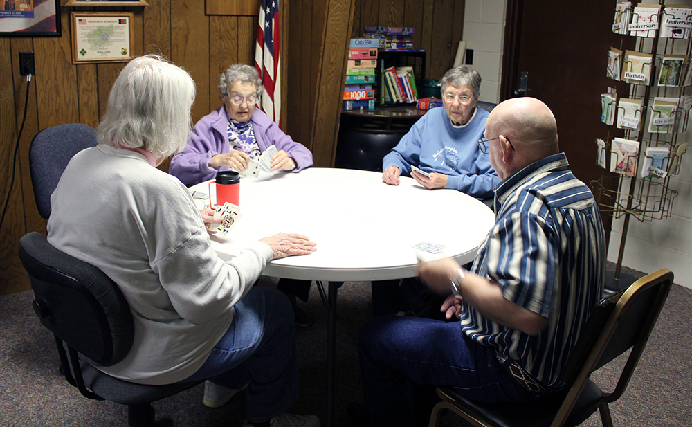 Patrons playing cards at Davenport Senior Center