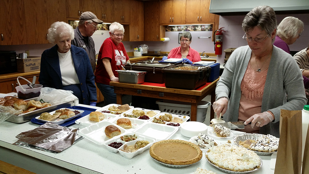 Dishing up meals at Cortland Senior Center