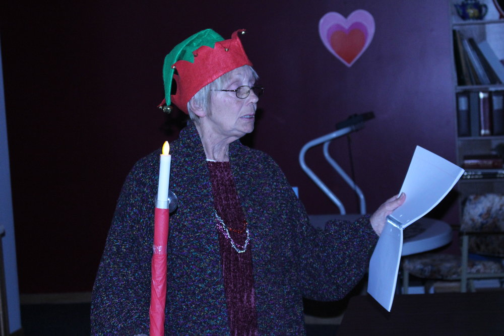 "Palmyra Senior Center manager Connie Coffey dressed as the ""town cryer"" during the Valentine's Day party."