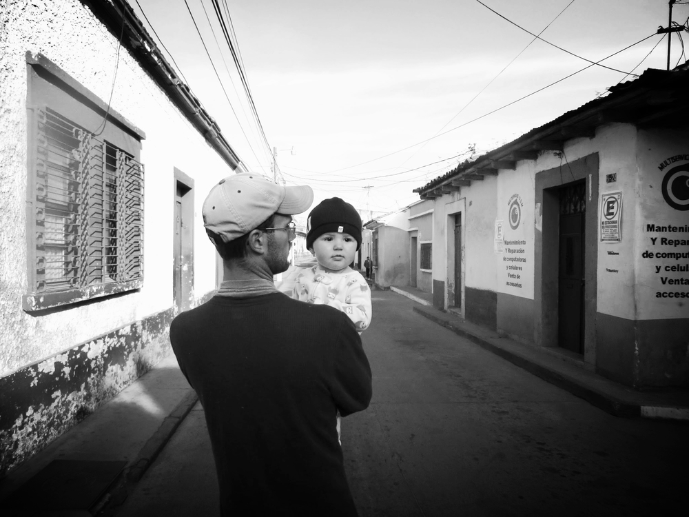 Husband and Toddler {at 9 months} walking through our neighborhood streets in Guatemala.