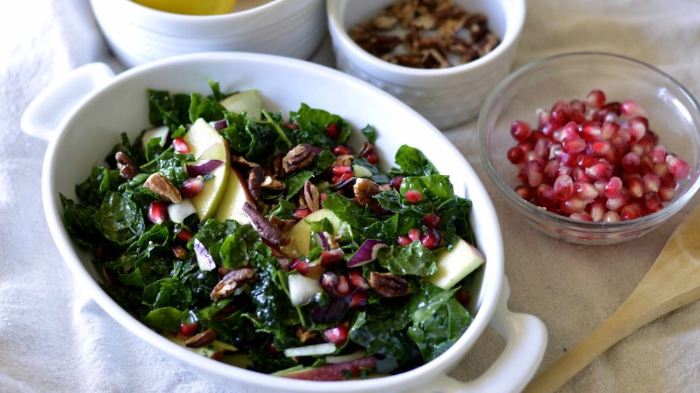 Paleo Kale Salad with Pomegranates and Citrus Dressing