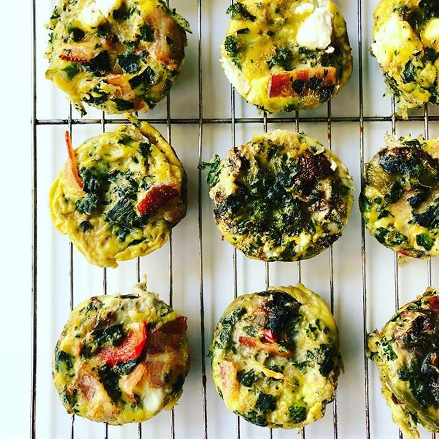 Monday morning mini egg muffins ☀️ // getting a head start on the day's veggie count 🎯 ✅  Here's how these came together last night: preheat oven to 350 F. Mix 12 eggs in a bowl. Sauté a bunch of veggies — in this case: frozen chopped spinach, frozen bell peppers from @traderjoes, diced cooked bacon, a handful of diced onions and mushrooms. Add a dash of S & P and garlic powder. Combine eggs and veggies. Pour into lightly greased (with coconut oil) muffin pan. I topped half with goat milk cheese. Bake for 20-25 minutes.