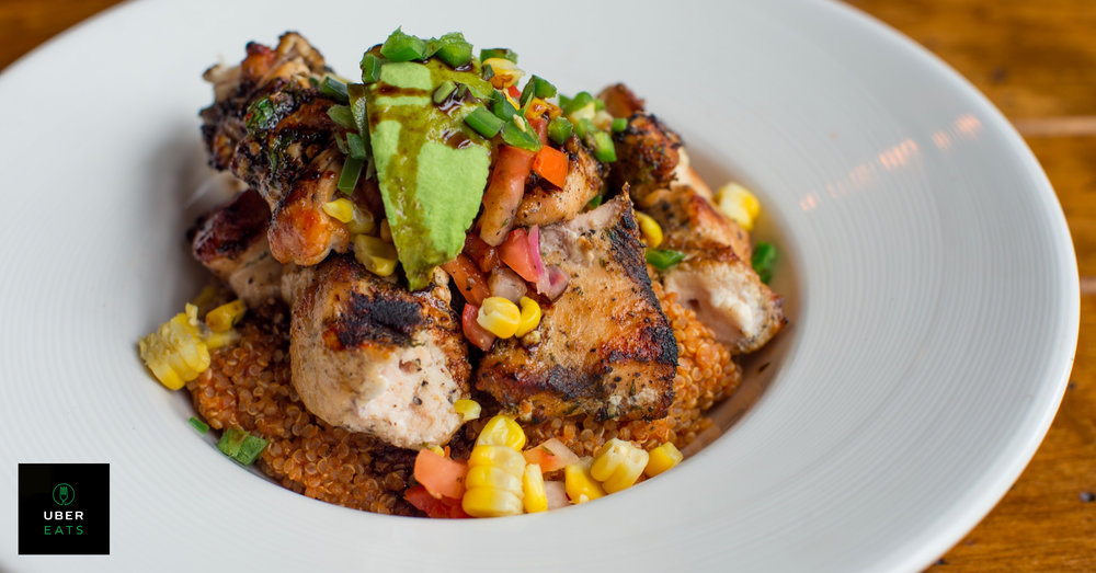 Chimmichurri Chicken Quinoa Bowl - Grilled chimichurri-marinated chicken, diced avocado, roasted corn, minced jalapeño, and balsamic syrup. Pearl grain simmered in molido broth