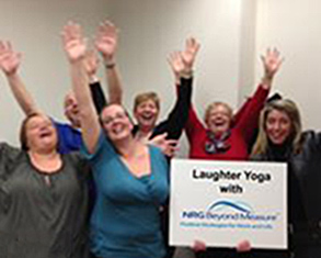 Assured Healthcare Staff enjoying Laughter Yoga.