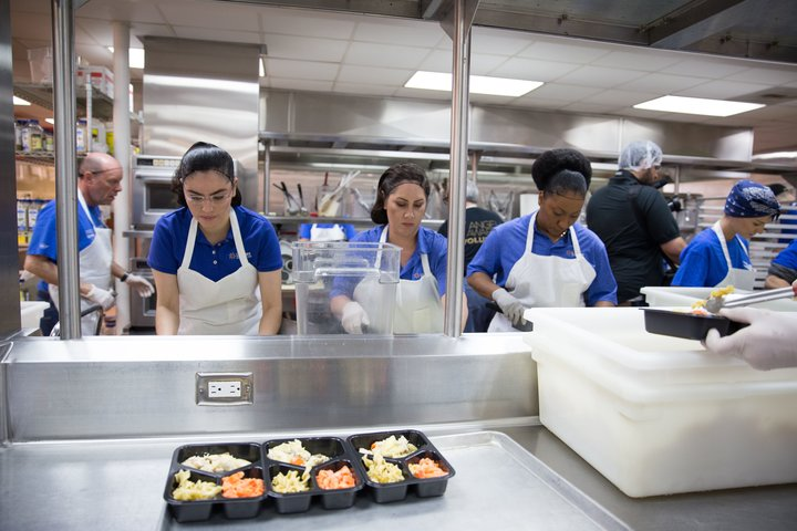 Volunteers prepare meals for delivery at Project Angel Food in Los Angeles. The photo was taken after a press conference on May 4, 2018, announcing the beginning of a pilot program to deliver low-sodium meals to people with congestive heart failure in Los Angeles county.  Photo courtesy of La Care Health Plan