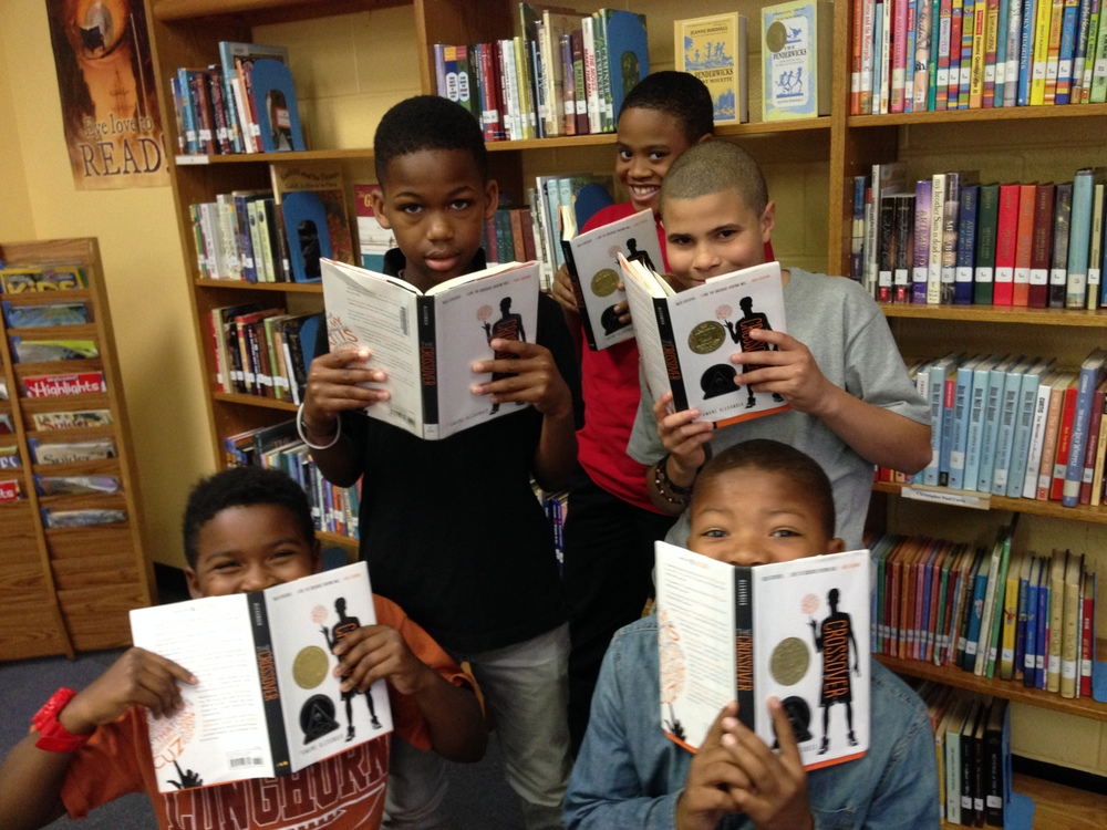 """Khalil Sommerville, Novaun Lee, Kyle Brewer, Kofi McFadgion, and Joseph Dail from Watkins Elementary on Capitol Hill composed a song about Kwame Alexander's Newbery Award winning book """"The Crossover."""""""