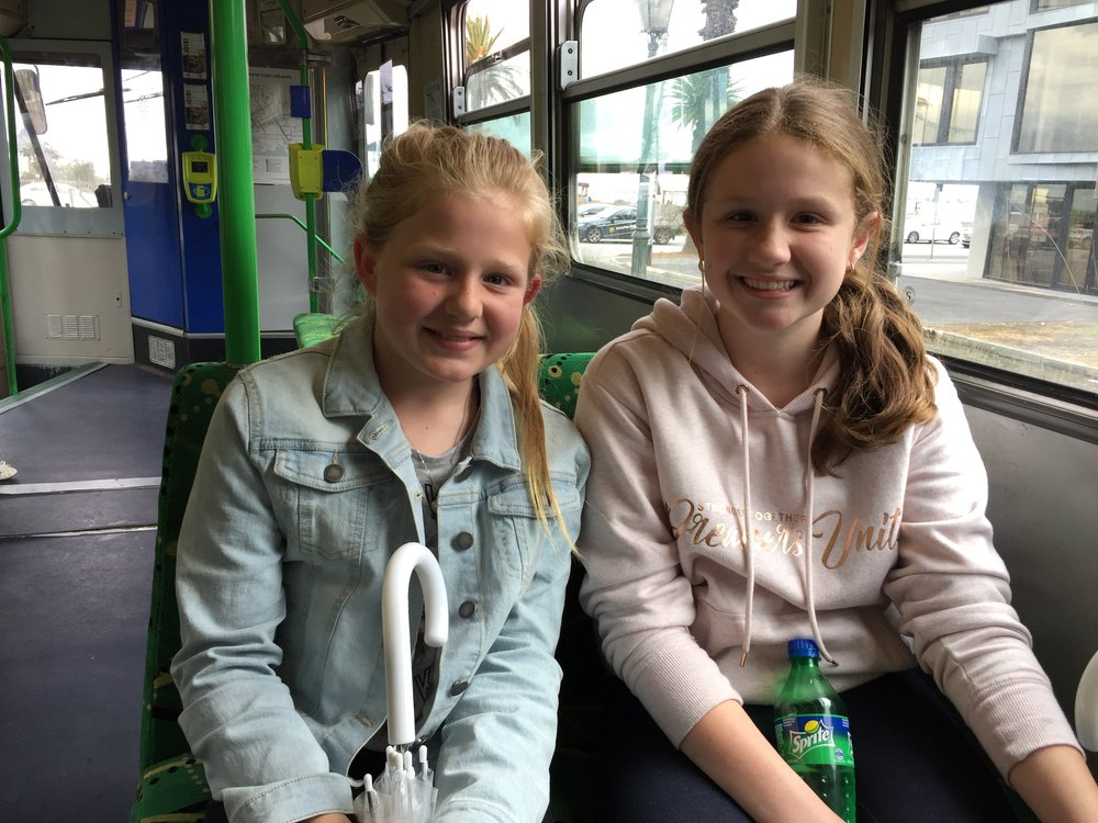 Kalie and April share their favorite books on a tram in Melbourne, Australia