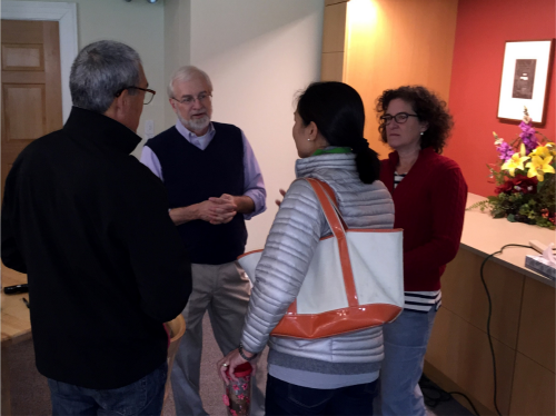 Dr. Kevin Mattingly speaks with John Lin, Marilee Lin, and Sarah Barton following a full day of presentations.  This photo was originally posted as a Head's Photo.