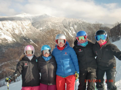 Often mistaken for a student, Leigh Anne Connors (second from left) blends in with some of her skiers on Cannon Mountain.