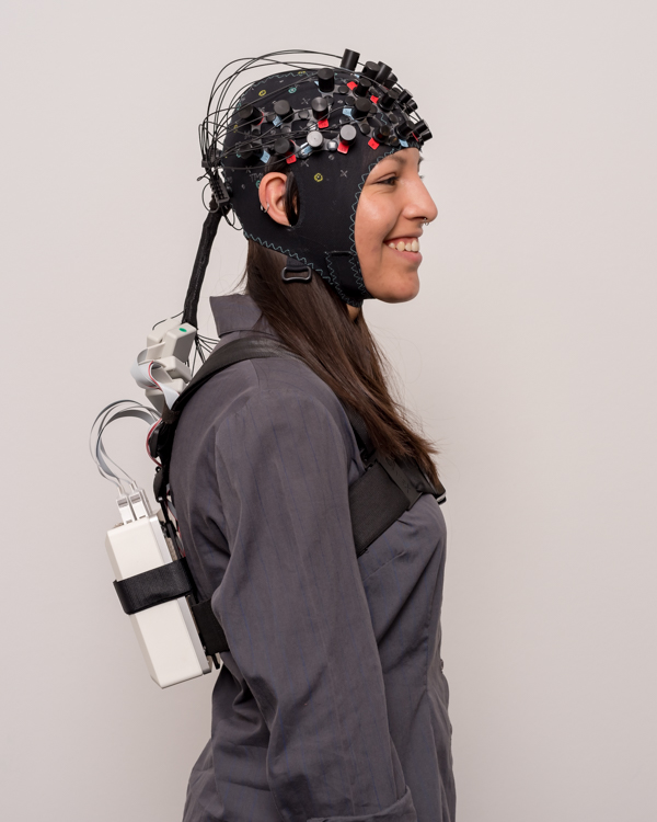 NIRSport 2 with back strap for mobile applications:  the system weighs only ~800g. Keeping the amplifier on the back, rather than mounting it to the head cap, leaves the head and neck free to move in a naturalistic way.
