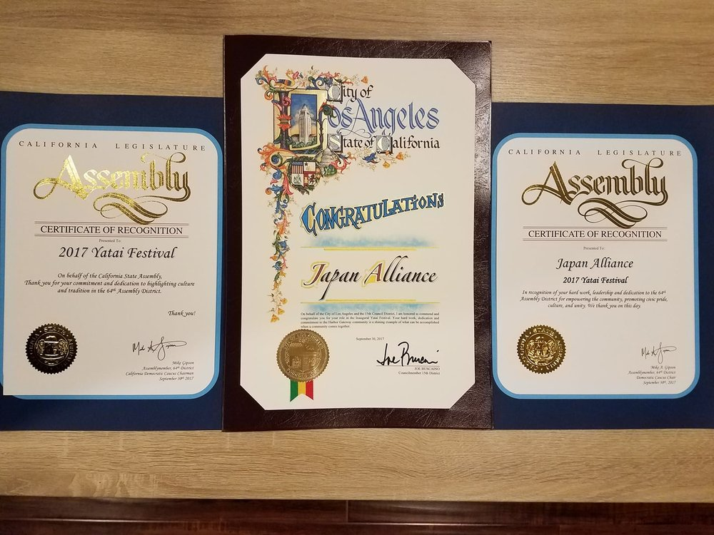 WE ARE SO HONORED TO BE RECOGNIZED BY ASSEMBLYMEMBER MIKE GIPSON AND COUNCILMEMBER JOE BUSCAINO BUT PLEASE KNOW THAT WE HUMBLY ACCEPT IT ON BEHALF OF ALL OF THE VOLUNTEERS WHO WERE BEHIND THE SCENES AND QUIETLY MADE THINGS HAPPEN; ALL OF THE KIDS WHO WITNESSED THEIR COMMUNITY BEING SHAPED BY THE INDIVIDUALS WHO CARE SO MUCH ABOUT UNITY AND THE PRESERVATION OF A CULTURE; THE VENDORS, RESTAURANTS, AND ENTERTAINERS WHO TOOK A CHANCE AND HELPED MAKE THE EVENT UNFORGETTABLE; AND ALL OF OUR ATTENDEES WHO COULD HAVE BEEN AT ANY OF THE OTHER WONDERFUL EVENTS GOING ON TODAY BUT CHOSE TO BE A PART OF SOMETHING NEW. THIS RECOGNITION ISN'nt ONE FOR US BUT FOR ALL OF YOU AND WE CANNOT THANK EVERYONE ENOUGH FOR ALLOWING US TO BE A PART OF SOMETHING SPECIAL. WE HOPE YOU ENJOYED THE 2017 YATAI FESTIVAL AND-- DARE WE SAY-- SEE YOU NEXT YEAR