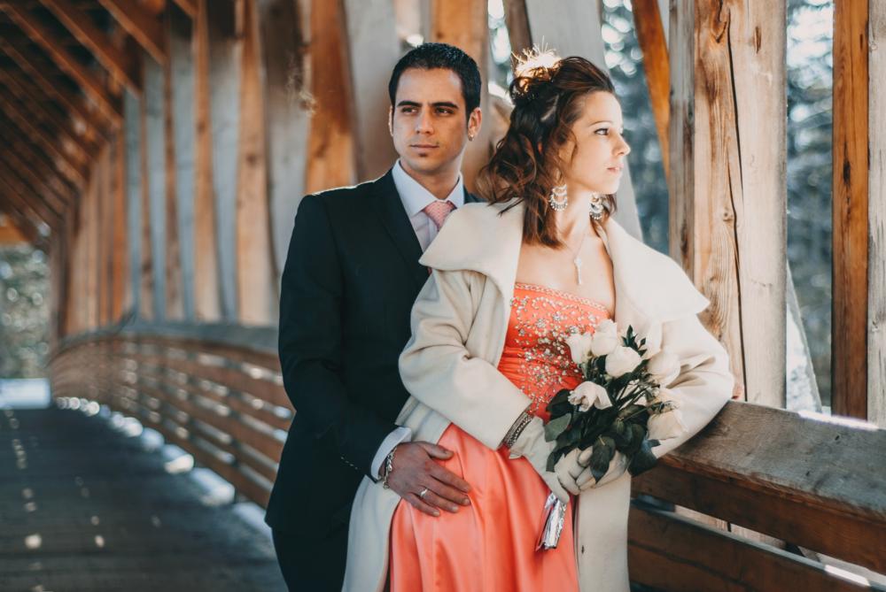 golden-wedding-couple-on-bridge.png