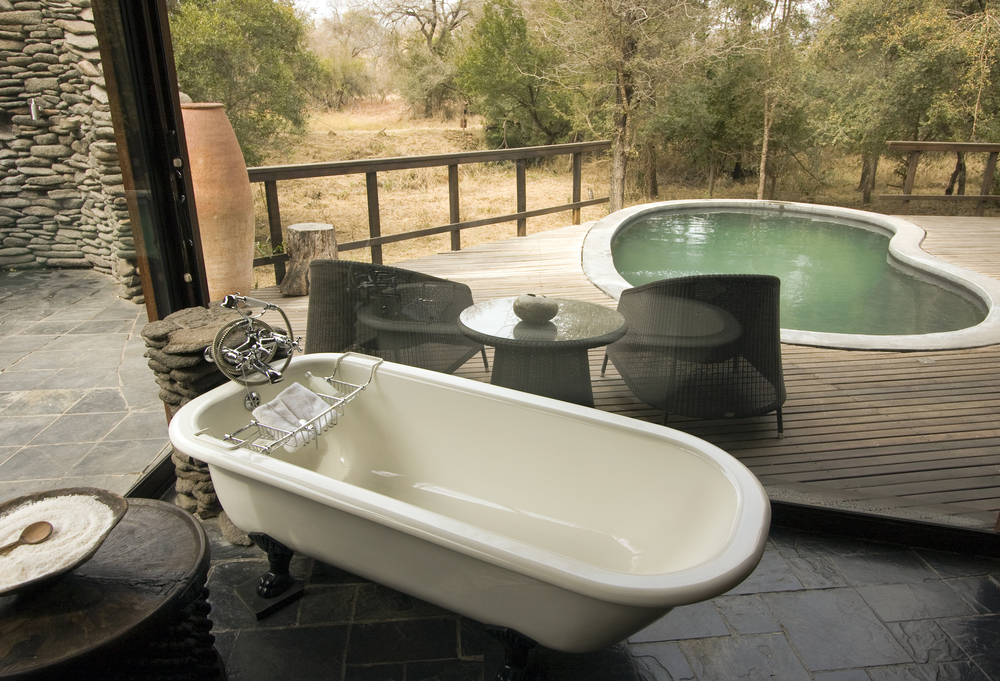 Copy of Luxury Lodge - bathtub & swimming pool.jpg