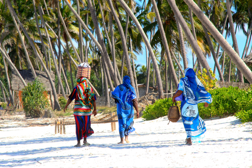 Zanzibar+-+women+wearing+colorful+clothes+walking+on+beach.jpg