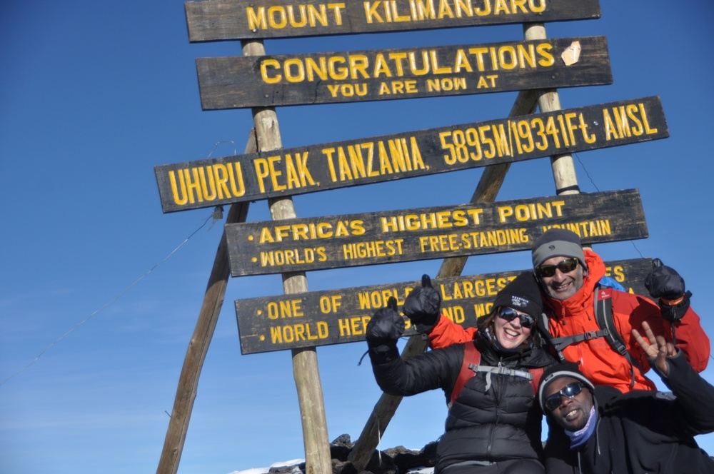 Kilimanjaro - Piush, Nico, and guide at the summit.JPG