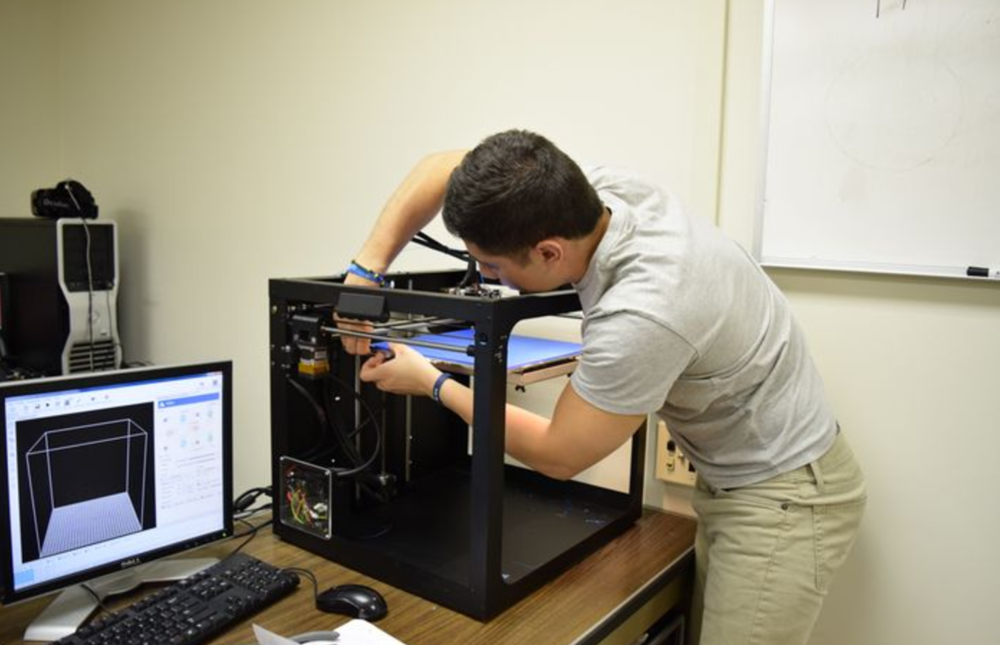 Courtesy of Dan McMahon | A student from Penn State works on a printer at Solid Dynamics LLC, College Township, Centre County. There has been increasing and widespread adoption and innovation of additive manufacturing technology, conventionally known as 3-D printing.