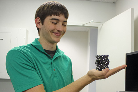 Joseph Sinclair displays a project printed on one of his 3-D printers.    Image: Rachel Baker